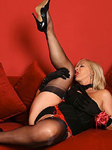 Astrid in black full fashion seamed nylon stockings and black heels