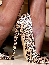 Astrid in leopard heels and black full fashion nylon stockings showing off her beautiful legs and large tits