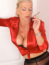 Astrid smoking in red silk top and black tights