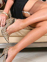 Emma in nude full fashion nylon stockings and leopard heels showing her sexy legs, ass and breasts