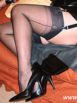 Lady Lucy in sexy black full fashion nylon stockings and black leather dress and heels