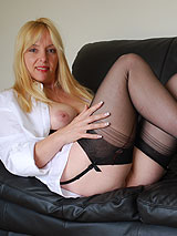 Lucy in black lingerie, garters and stockings