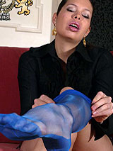 Lucy Van Angel in blue full fashion nylons giving foot sex and a nice blow job