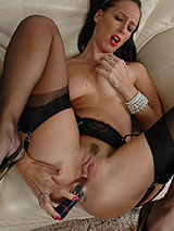 Filthy Tammie Lee in nylons uses two sex toys on herself