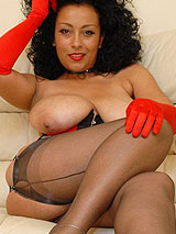 Huge tit MILF Danica on the couch in dark stockings showing her beautiful legs, pussy and tits