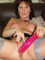 MILF Wendy Taylor teasing with her beautiful legs in nylon stockings and playing with her pussy