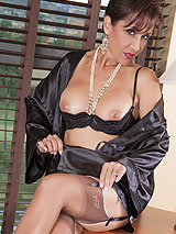 Hot MILF Roni in sexy black lingerie with taupe full fashion nylon stockings
