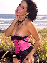 Beautiful Roni seaside in pink and black corset with black stockings showing her sexy legs, ass and breasts
