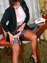 Sexy Roni at office desk with blue nylon stockings and white garters showing off her shapely legs and body