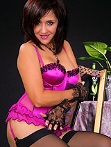 Roni in violet corset and black stockings showing her beautiful legs and ass